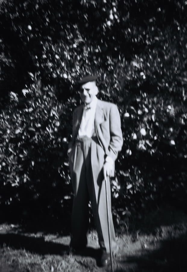 Hans Weiss in garden of Orange Grove home